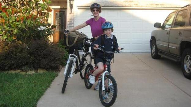 """Jennifer Drake and her daughter, Alex, pause before their morning ride. """"My daughter and I bike to school (her work) 3 miles roundtrip daily,"""" Drake writes. (@JennLDrake)"""