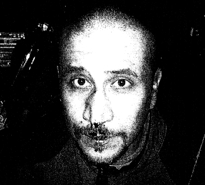 A photocopy of a picture of George Zimmerman taken the night of the shooting.