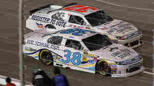 """The Faith and Freedom Coalition has gone as far as sponsoring a race car with """"Register to Vote"""" emblazoned on the side. Reed Sorenson drove the No. 32 car during a NASCAR Sprint Cup Series race at Richmond International Raceway on April 28 in Virginia."""