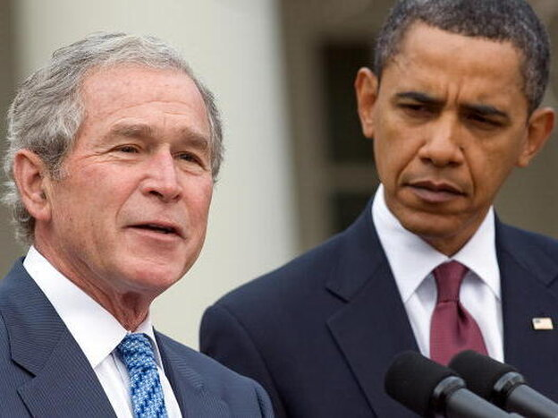 Former President George W. Bush, standing with President Obama, speaks about relief effor