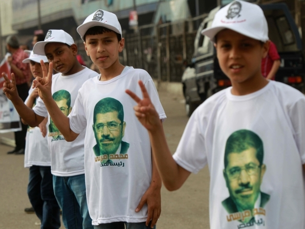 Among the candidates in Egypt's presidential election is Mohammed Mursi of the Muslim Brotherhood. Here, his young supporters campaign for him on the outskirts of Cairo on Thursday.