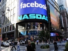 A sign welcoming Facebook is flashed on a screen outside the NASDAQ stock exchange as people walk by on Times Square in New York on Friday. Facebook went public Friday.
