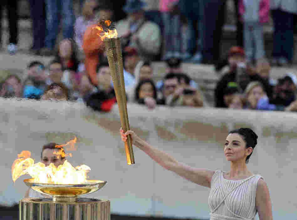 Actress Ino Menegaki, dressed as a high priestess, lights the torch at a ceremony in Panathinean stadium in Athens.