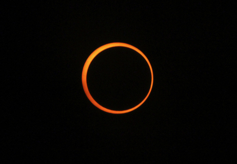 An annular solar eclipse is seen over Myanmar on Jan. 15, 2010 as the moon crossed the sun's path, blocking everything but a narrow, blazing rim of light.