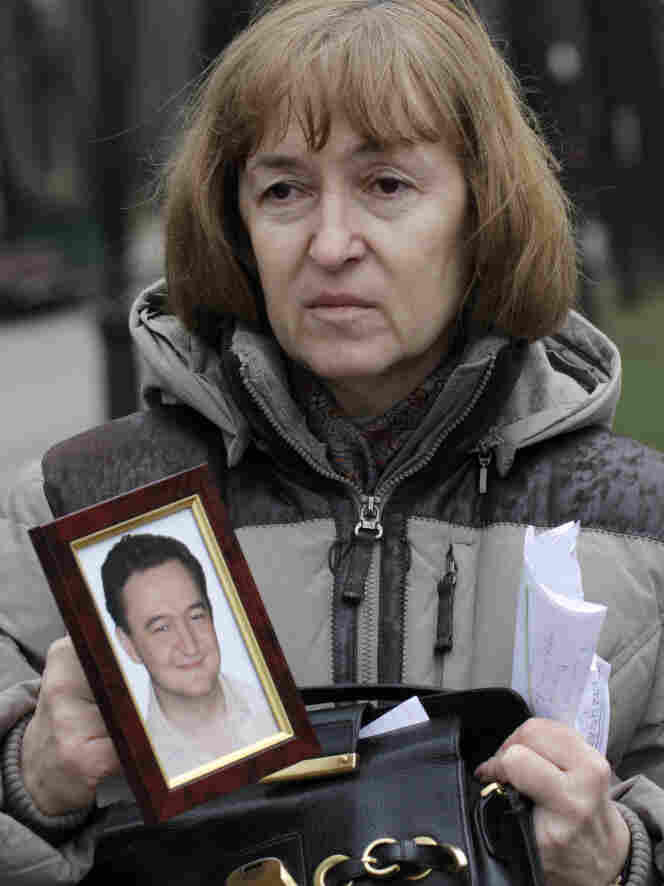 Magnitsky's mother, Nataliya Magnitskaya, holds a photo of her son in Moscow, in 2009.