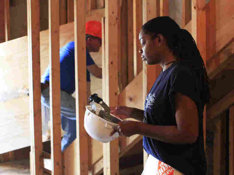 Cara Fuller, training director of the building program, says it's learning workplace etiquette, not construction skills, that is challenging for trainees.
