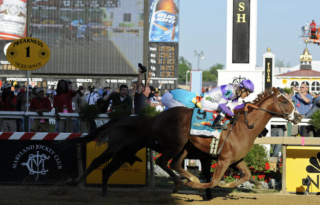 I'll Have Another (9), ridden by Mario Gutierrez, beats Bodemeister, ridden by Mike Smith, to the finish line to win the 137th Preakness Stakes horse race at Pimlico Race Course