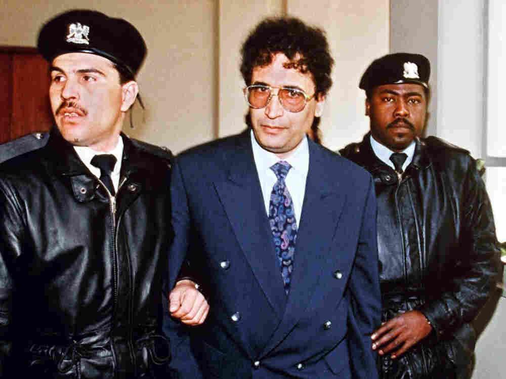 Security officers escort convicted Lockerbie bomber Abdel Baset al-Megrahi (center) in Tripoli in 1992.