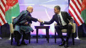 President Obama shakes hands with with Afghan President Hamid Karzai during their meeting at the NATO Summit in Chicago on Sunday. The summit, which continues Monday, is focusing heavily on Afghanistan's future.