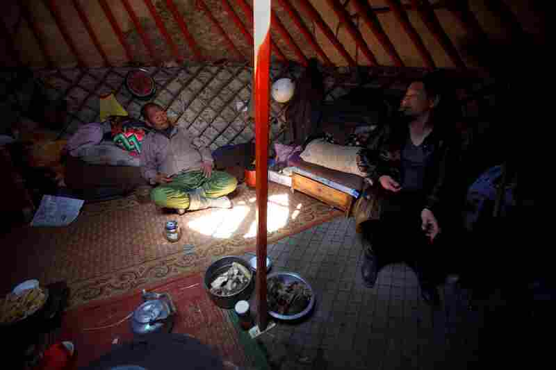 In South Gobi province, a local politician (right) and a herder sit inside a traditional yurt, or ger, and discuss the lack of water in the area. Herdsmen worry that mines — which require massive amounts of water to process ore — will deplete already diminishing supplies.