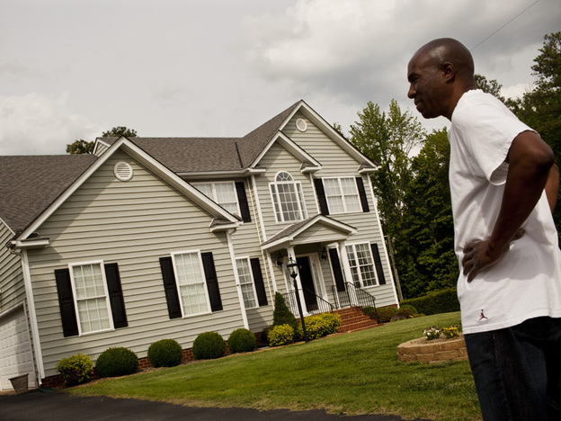 Frank stands outside his home in Glen Allen, Va., which he co-owned with his mother, Ida. The family recently sold the home in order to free up money for Ida's care.