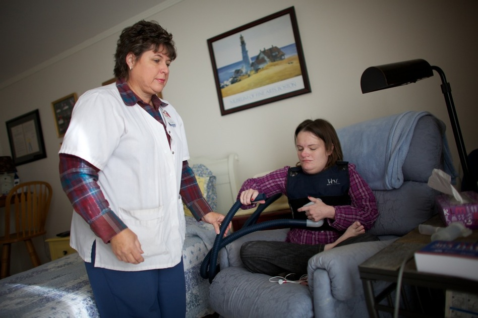 Nurse Vicki Hagen comes over to Beckett's apartment in Cedar Rapids, Iowa, to help fit her with a vibrating vest that helps clear mucous from her lungs twice a day. Studies have shown that, almost always, it costs less to care for someone at home than in a nursing home or hospital. (NPR)