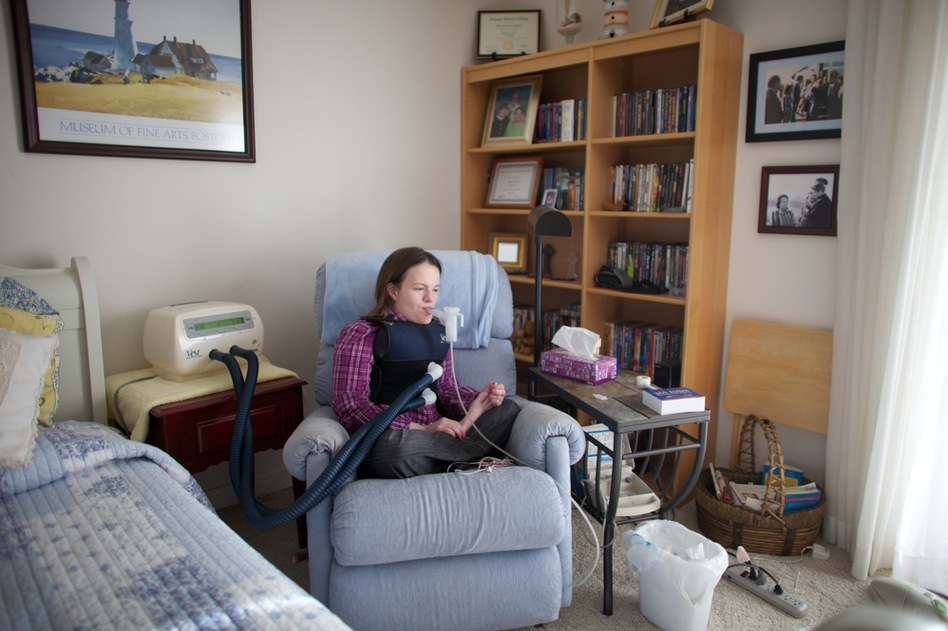 "On the wall of her apartment are pictures of Beckett as a child with President Reagan. Reagan created the ""Katie Beckett waiver"" that changed the Medicaid rules to allow severely disabled children and adults to get government-funded care in their own homes. (NPR)"