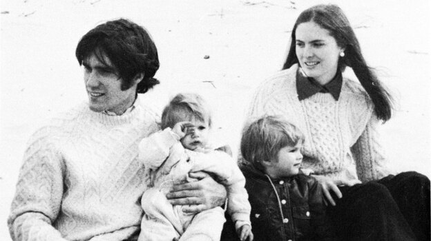 Mitt Romney already had a young family during his time at Harvard, which set him apart from most other students. Here, Romney is with his wife, Ann, and two sons at a business school clambake in 1973. (Courtesy of The New York Times)