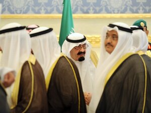 Saudi King Abdullah bin Abdul Aziz shakes hands with arriving delegations during a welcoming ceremony for Gulf Cooperation Council (GCC) leaders attending a summit in Riyadh on May 14, 2012.