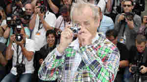 Bill Murray snaps a few at a Cannes press event on May 16.