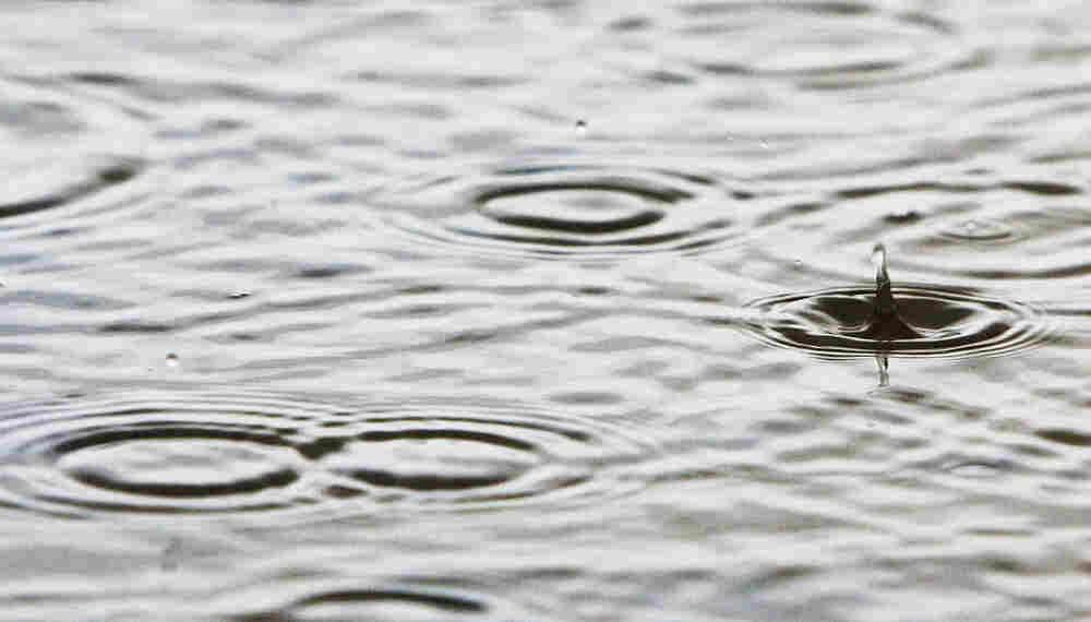 Rain falls, forming puddles on the Birdsville Track, June 9, 2005, near Marree, Australia.