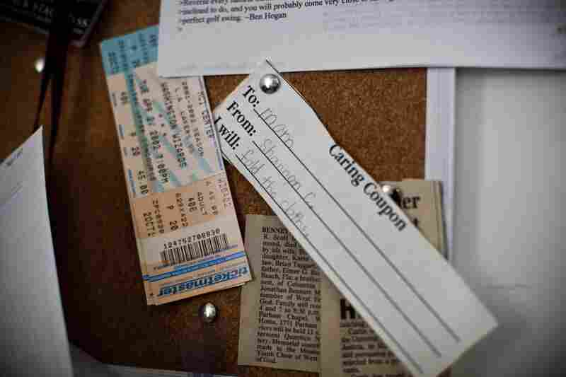 """A """"caring coupon"""" given by Shannon to her mother hangs on a bulletin board in Frank's home office."""
