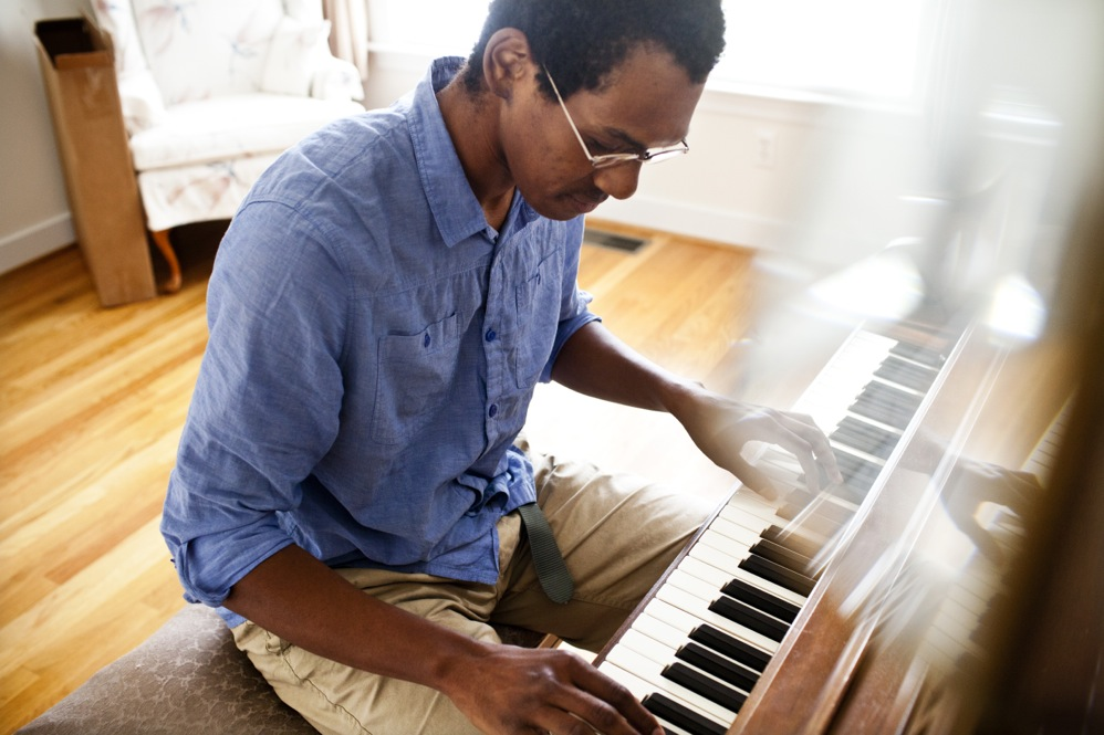 "Jonathan plays Ida's piano, which he says she won in a raffle in 1976. Jonathan remembers Ida playing hymns and folk-type music. ""I grew up with Ida,"" he says. ""I used to drive her to church every Sunday. She was always laughing."""