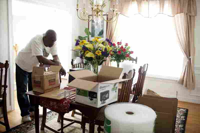 """Frank takes a break from packing in the family's dining room. He says the new homeowner bought their house because of the downstairs en suite bedroom and bathroom. """"She is a single mom and will be taking care of her parents,"""" he says."""