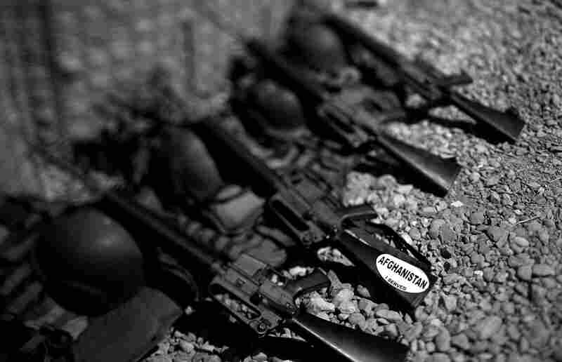 """An Afghan army M-16 rifle has a sticker on it that reads, """"Afghanistan, I served."""""""