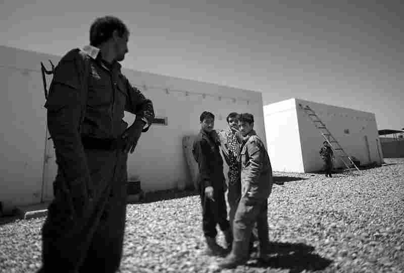 Afghan local police officers wait outside a classroom at a training facility in Marjah. U.S. Marines are training local security forces how to maintain calm in the region.