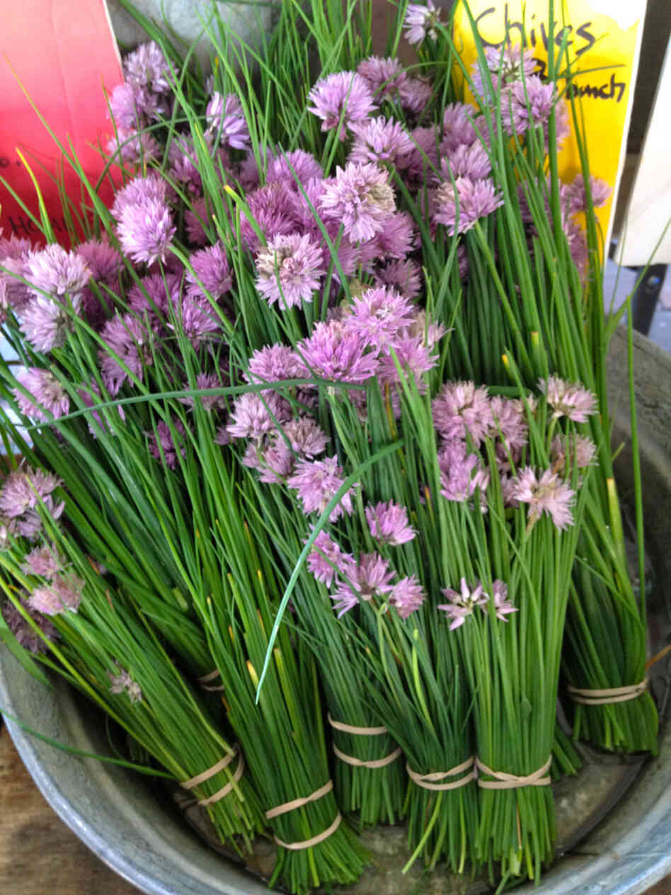 Herb blossoms, such as these chive blossoms from Westminster, Md.-based Gardeners Gourmet at Eastern Market in Washington, D.C., are a colorful addition to this zesty salad.