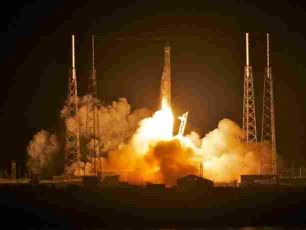 SpaceX's Dragon capsule, atop the company's Falcon 9 rocket, as it blasted off before dawn this morning in Florida.