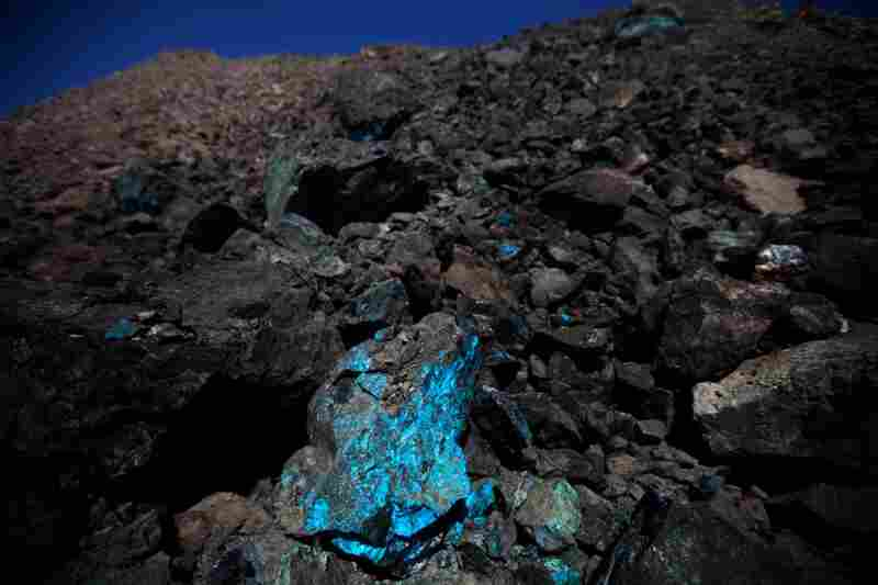 "Oxidized copper (visible here in one area of Oyu Tolgoi's open-pit mine) gave the mine in the southern Gobi region its name, which means ""Turquoise Hill""."