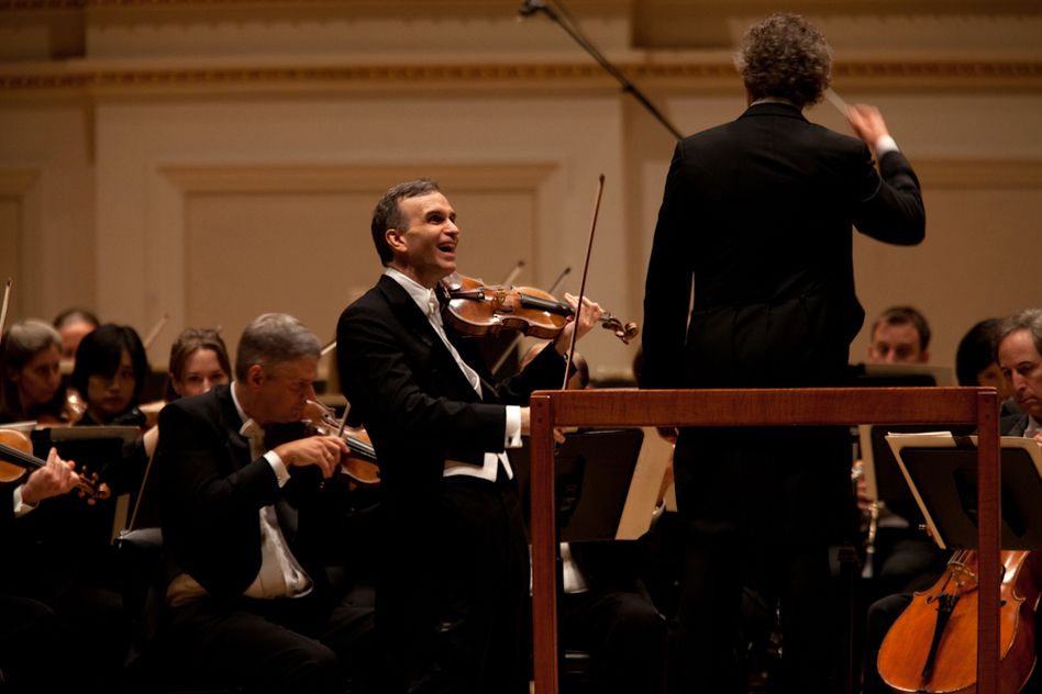 The amiable Shaham often flashed a smile whenever he finished a phrase of the Brahms concerto.  (Melanie Burford for NPR)