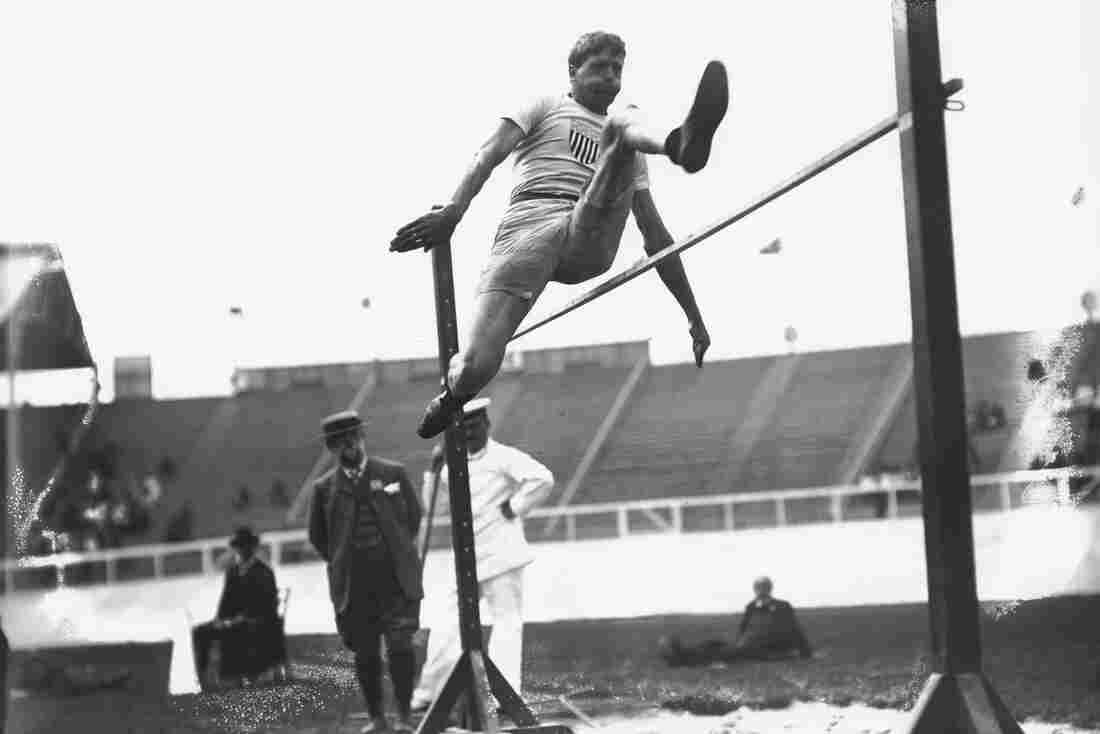 Ray Ewry wins the standing high jump at the 1908 Summer Olympics in London. Ewry won 10 gold medals, all after having overcome polio as a child.