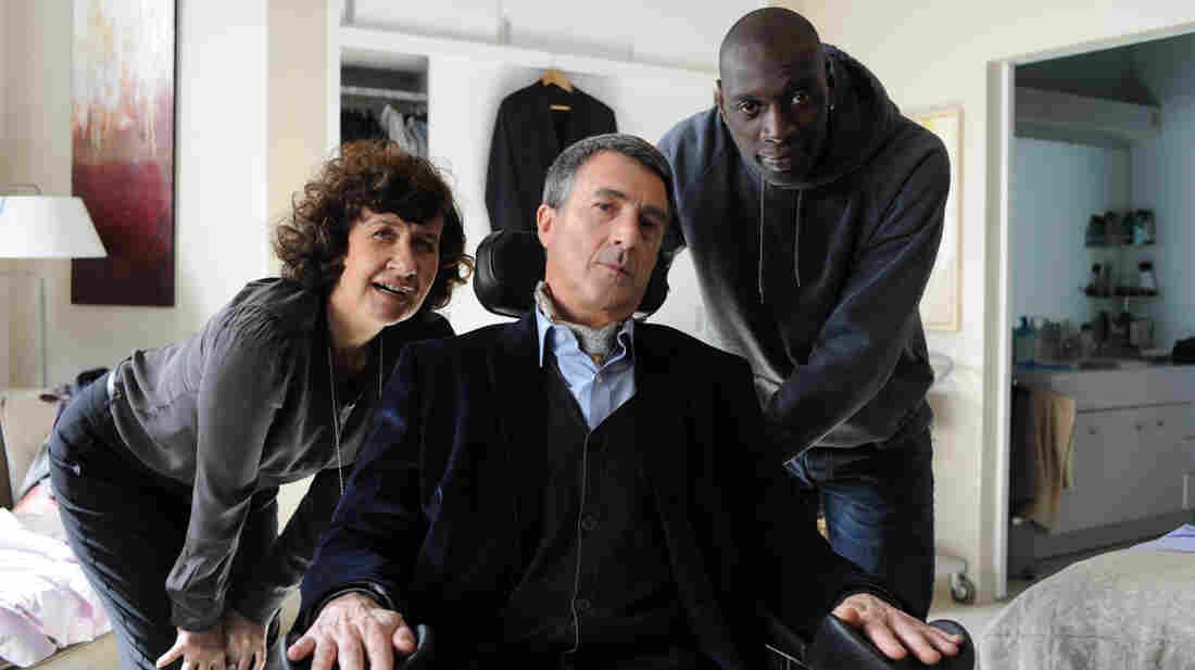 Paralyzed after a paragliding accident, wealthy daredevil Philippe (Francois Cluzet) hires Driss (Omar Sy), a cocky ex-con, despite the concerns of his aides, including Yvonne (Anne Le Ny).