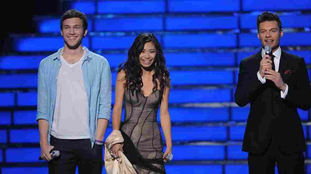 American Idol finalists Phillip Phillips and Jessica Sanchez on stage with host Ryan Seacrest on the Fox TV show Tuesday night.