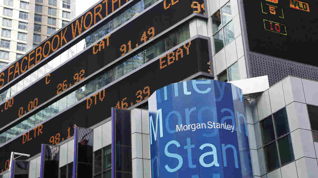 A financial news stock ticker on Morgan Stanley headquarters carries a headline about Facebook on Wednesday. Some investors wonder whether Facebook and Morgan Stanley withheld information before the Facebook stock offering.