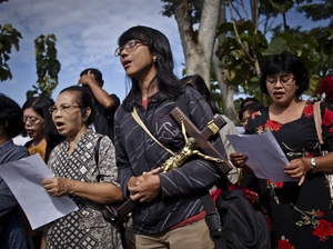 Indonesian Catholics pray during a re-enactment of the crucifixion of Jesus Christ on April 6, Good Friday, in Klaten, Indonesia.