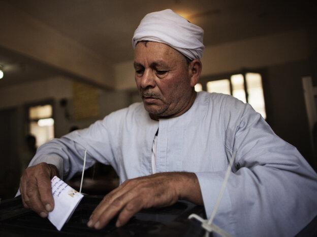 In Cairo, earlier today, a man cast his ballot.