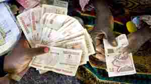 How Crumbling U.S. Dollars Bailed Out Zimbabwe
