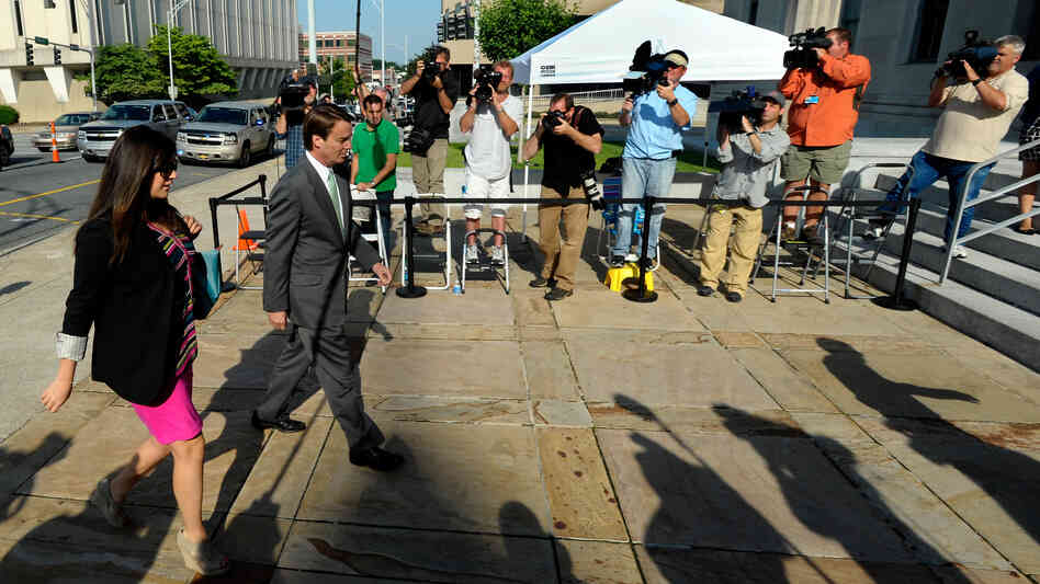 John Edwards arrives with his daughter, Cate Edwards, at U.S. District Court in Greensboro, N.C., on May 17 for closing arguments in his trial. The former Democratic presidential candidate has pleaded not guilty to six counts of campaign finance violations.
