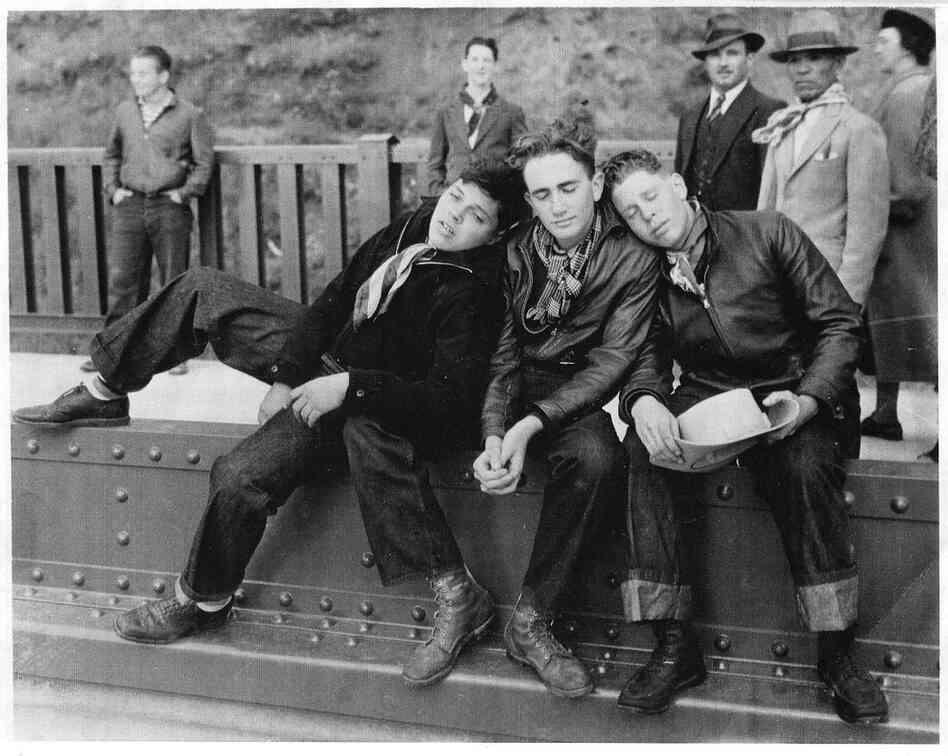 Edgar Stone (left), Marshall Weigel and Stuart Greenberg were exhausted after walking across the Golden Gate Bridge on the day it first opened. A photographer snapped them for this image, which appeared in The San Francisco News-Call Bulletin.