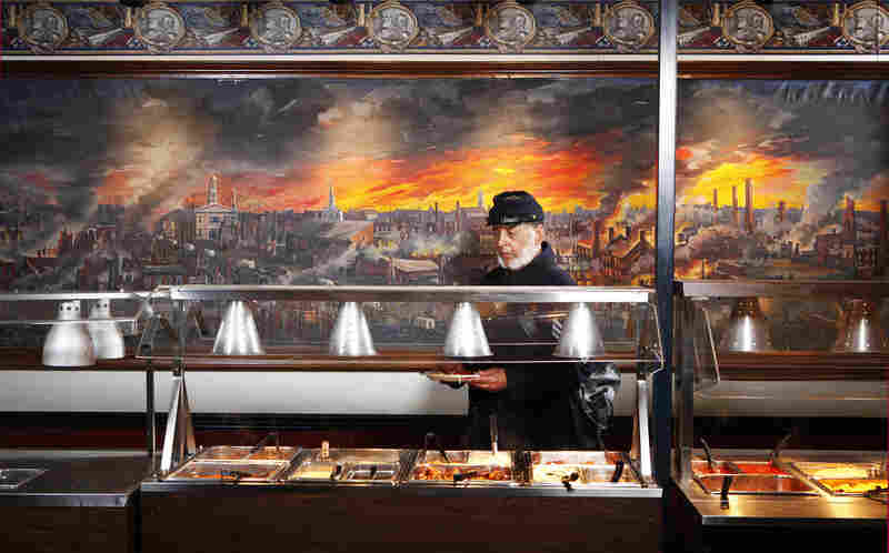 Ben Hawley, 54th Massachusetts, at Pickett's Buffet, Gettysburg, Pa. The 54th Massachusetts infantry, a unit of black Union soldiers, was portrayed in the film Glory. The mural behind Hawley depicts the collapse of the Confederacy.