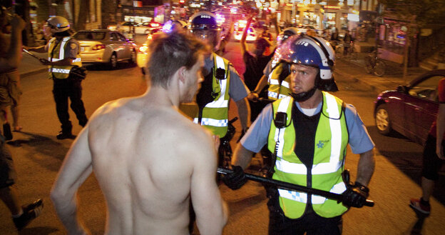 Montreal police and protesters face off on Wednesday during a demonstration against student tuition hikes.