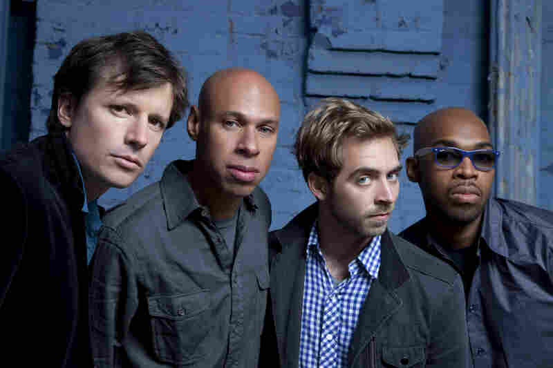 In this promotional image of the band James Farm, Joshua Redman is second from left, and Aaron Parks is to his left.