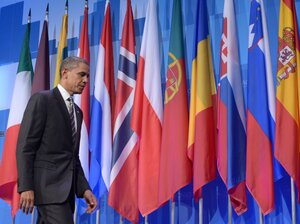 President Barack Obama leaves a press conference at the conclusion of the 2012 NATO Summit May 21, 2012 in Chicago.