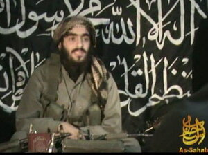 This 2010 image, provided by IntelCenter, shows Humam Khalil Abu-Mulal al-Balawi in a posthumous video message posted on extremist websites. Th