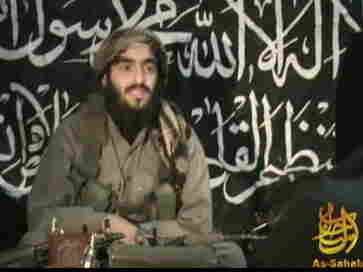 This 2010 image, provided by IntelCenter, shows Humam Khalil Abu-Mulal al-Balawi in a posthumous video message posted on extremist websites. The al-Qaida double agent killed seven CIA operatives, a Jordanian spy and himself when he set off a bomb strapped to his body at a base in Afghanistan in December 2009.