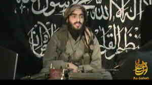 This 2010 image, provided by IntelCenter, shows Humam Khalil Abu-Mulal al-Balawi in a posthumous video message posted on extremist websites. The al-Qaida double agent killed seven CIA operatives, a Jordanian spy and himself when he set off a bomb strap