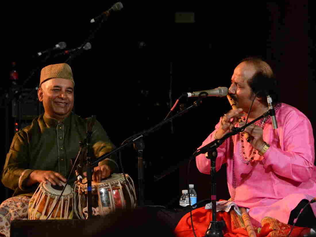 Tabla player and concert organizer Samir Chatterjee plays alongside flutist Ronu Majumdar at Chhandayan's annual all-night concert in New York City in May.