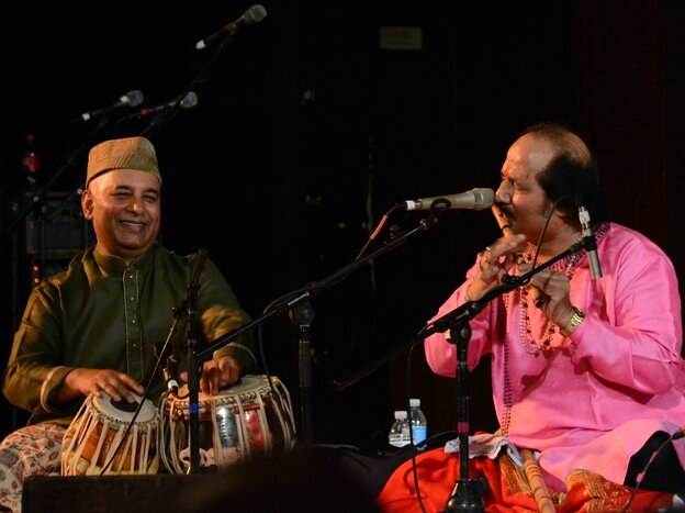 Tabla player and concert organizer Samir Chatterjee plays alongside flutist Ronu Majumdar at Chhandayan's annual all-night concert in New York City in May.