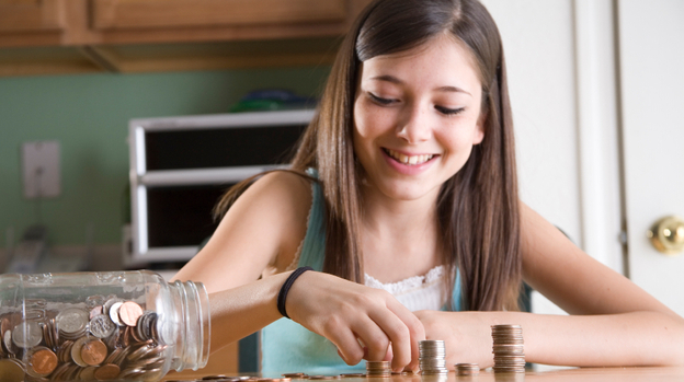 Parents can make a difference in whether their kids become spenders or savers, studies find. (iStockphoto.com)