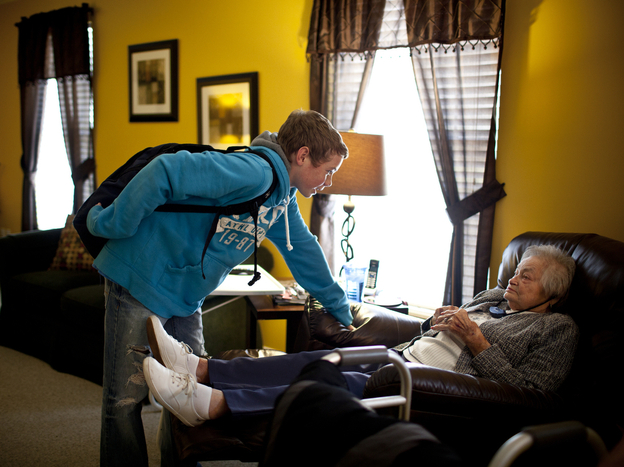 Chris Martin, 14, greets his great-grandmother AnnaBelle Bowers, 87, who lives part time with the Martin family in Harrisburg, Pa.